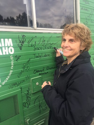 Tracy Olson signing bus