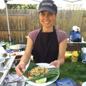 Chef E serving food